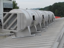 FERCHER Spraytunnel installed on inclined roof,  outlet with demister